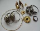Коллекция древних золотых и серебряных серег и фибул